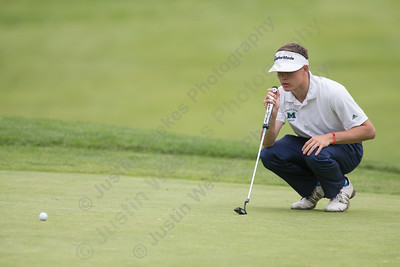 Maloney's Demetre Carnot crouches to read the 12th green before putting Tuesday at Hunters Golf Club in Meriden May. 23, 2017 | Justin Weekes / For the Record-Journal