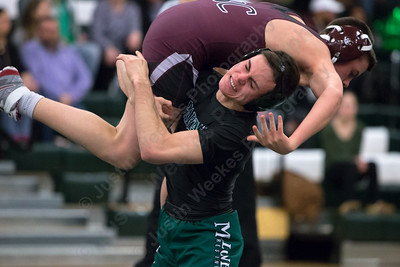 Maloney's Demetre Carnot takes down Bristol Central's Jared Parsons  Wednesday at Maloney High School in Meriden January 24, 2018 | Justin Weekes / Special to the Record-Journal