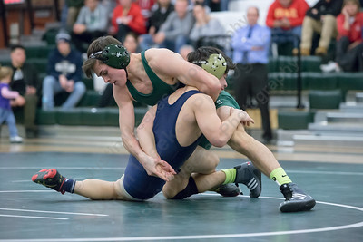 Maloney's Demetre Carnot turns Platt's Peyton Thiel for the pin in the 132 weight class Wednesday at Maloney High School in Meriden Feb. 8, 2017 | Justin Weekes / For the Record-Journal