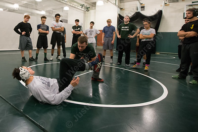 Maloney's head coach Eric Bergeron demonstrates a take down with Demetre Carnot Monday during practice at Maloney high School in Meriden December 11, 2017 | Justin Weekes / For the Record-Journal