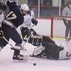 2-12-2010...Ramsey's  Brandon Hasslinger (17) battles to score with Paramus Catholic's Bryan Nagy as Paramus Catholic's goaltender Kevin Murley is down with his back turned.<br /> PHOTO: KELLY BIRDSEYE