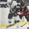 2-28-2010...Glen Rock's Drew Boyer (9) and Patrick Rutkowski of Ramsey battle for the puck against the boards in the NBIL A championship.<br /> PHOTO: KELLY BIRDSEYE