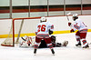 Baldwinsville Brad Burlingame (17) begins to celebrate his game winning goal against the Auburn Maroons as teammate Dan Briggs (26) looks on at the Greater Baldwinsville Ice Arena on Tuesday, February 2, 2010. Baldwinsville posted a 4 to 1 win.
