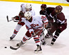 Baldwinsville's Kevin Cullen (10) holds off two Auburn Maroon defenders at the Greater Baldwinsville Ice Arena on Tuesday, February 2, 2010. Baldwinsville posted a 4 to 1 win.