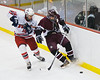 Bldwinsville forward John Waldon (16) checks the Auburn Maroon defender  at the Greater Baldwinsville Ice Arena on Tuesday, February 2, 2010. Baldwinsville posted a 4 to 1 win.