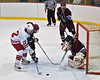 Mike McElwain (12) of Baldwinsville gets ready to tip the puck towards the Auburn Maroon goalie Jeffrey Gardner at the Greater Baldwinsville Ice Arena on Tuesday, February 2, 2010. Baldwinsville posted a 4 to 1 win.