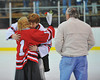 Mark Miller being congratulated at Senior Night for the Baldwinsville Varsity Ice Hockey team before the game against Ithaca on Friday, February 5, 2010.