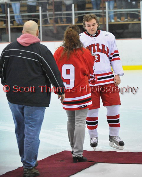 Devin Colclough being congratulated at Senior Night for the Baldwinsville Varsity Ice Hockey team before the game against Ithaca on Friday, February 5, 2010.
