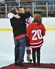 Paul Schneid being congratulated at Senior Night for the Baldwinsville Varsity Ice Hockey team before the game against Ithaca on Friday, February 5, 2010.