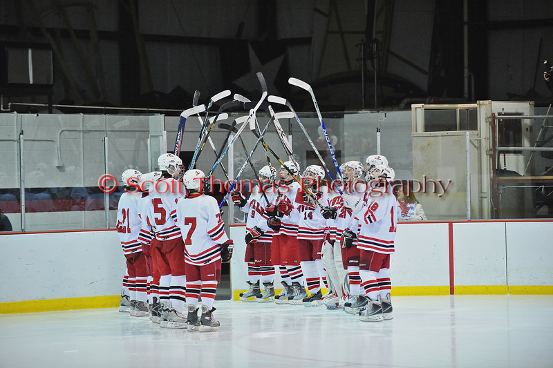 Underclassmen form a tunnel of hockey sticks during Senior Night for the Baldwinsville Varsity Ice Hockey team before the game against Ithaca on Friday, February 5, 2010.