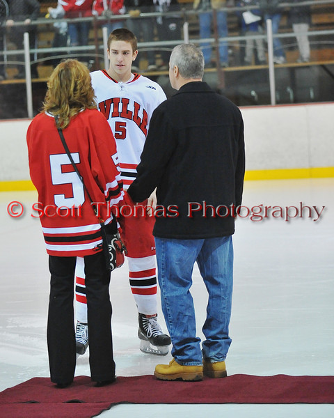 Conner Bertrand being congratulated at Senior Night for the Baldwinsville Varsity Ice Hockey team before the game against Ithaca on Friday, February 5, 2010.