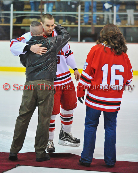 John Waldon being congratulated at Senior Night for the Baldwinsville Varsity Ice Hockey team before the game against Ithaca on Friday, February 5, 2010.