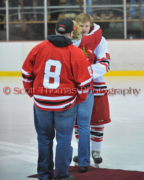 Greg Tedd being congratulated at Senior Night for the Baldwinsville Varsity Ice Hockey team before the game against Ithaca on Friday, February 5, 2010.