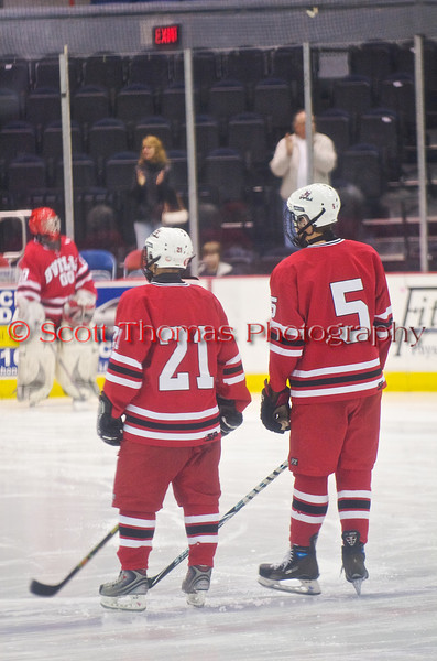 Defensemen Griffen Noffey (21) and Connor Bertrand (5) waiting on the blue line during player introductions before the Baldwinsville Bees, Liverpool Warriors  CNYHSHL hockey game in the Onondaga County War Memorial on Wednesday, January 20, 2010.  Baldwinsville won 10-0.