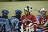 Baldwinsville Bees goaltender Mark Miller (1) greets oposing players from  the Oswego Buccaneers after the game Oswego won 2-0.