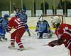Oswego Buccaneers goalie Matt Howard (1) stops a backhand shot by Baldwinsville's Sam Lane (15) in High School Boys Varsity Ice hockey action on Thursday, February 11, 2010. Oswego won 2-0.