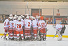 Baldwinsville Bees huddle up before a game against Ithaca Little Red in Section III High School ice hockey on February 5, 2010 in the Greater Baldwinsville Ice Arean.  Teams skated to at 3-3 tie.