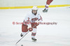 Baldwinsville Bees forward Brad Burlingame (17) carrys the puck through center ice in High School Boys Varisty Ice hockey action on Friday, January 15, 2010. West Genesee won 4-0.