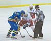Baldwinsville captain John Waldon (16) faces off against West Genesee center Casey Schnattner (12) in High School Boys Varisty Ice hockey action on Friday, January 15, 2010. West Genesee won 4-0.
