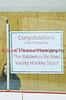 Congratulatory sign for Coach Lloyd of the Baldwinsville Bees Boys Varisty Ice hockey team on Friday, January 15, 2010.