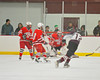 Baldwinsville Bees defenders Griffin Noffey (21), Parker Ferrigan (18) and Chris Johns (30) stop a shot by Corcoran Cougars Erik Kurz (12) at Mechem Rink in Syracuse, New York on Wednesday, December 22, 2010. Corcoran shutout Baldwinsville, 5 to 0.