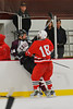 Baldwinsville Bees forward Parker Ferrigan (18) checks  Corcoran Cougars Steve Young (14) at Mechem Rink in Syracuse, New York on Wednesday, December 22, 2010. Corcoran shutout Baldwinsville, 5 to 0.