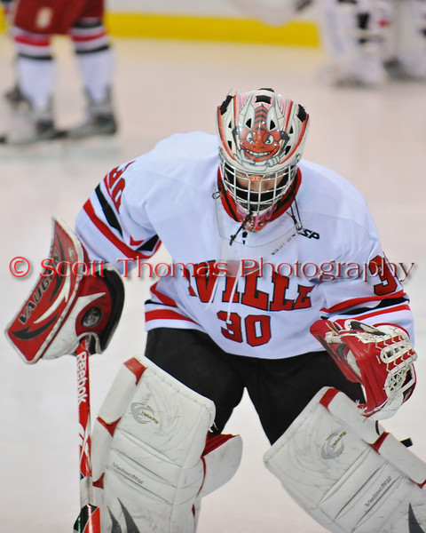 Baldwinsville Bees goaltender Chris Johns (30) prepares his crease before a game with the Cortland-Homer Golden Eagles in the Greater Baldwinsville Ice Arena in Baldwinsville, New  York on Thursday, December 16, 2010.
