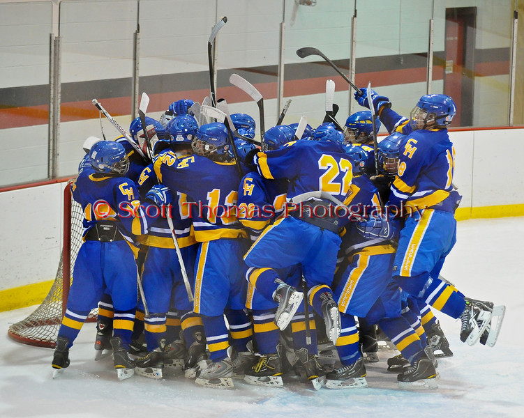 Cortland-Homer Golden Eagles celebrate a a 2 to 1 victory over the Baldwinsville Bees in the Greater Baldwinsville Ice Arena in Baldwinsville, New  York on Thursday, December 16, 2010.