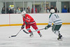 Baldwinsville Bees defensemen James Wadsworth (4) carrying the puck against Fayetteville-Manlius Hornets Taylor Bellina (16) in the Twin Rinks of Cicero, New York on Tuesday, January 4, 2011.  Baldwinsville won in overtime, 4 to 3.
