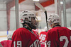 Baldwinsville Bees Senior captain Andrew Tiner (19) greeting teammates before playing the Fayetteville-Manlius Hornets in the Twin Rinks of Cicero, New York on Tuesday, January 4, 2011.  Baldwinsville won in overtime, 4 to 3.