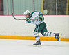 Fayetteville-Manlius Hornets captain Ryan Fero (24) clears the puck out of his end while killing a penalty against the Baldwinsville Bees in the Twin Rinks of Cicero, New York on Tuesday, January 4, 2011.  Baldwinsville won in overtime, 4 to 3.