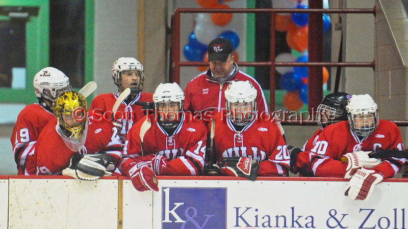 Baldwinsville Bees watch the action from the bench in a game against the Liverpool Warriors at the New York State Fairground's Coliseum in Syracuse, New York. Baldwinsville won 6 to 1.
