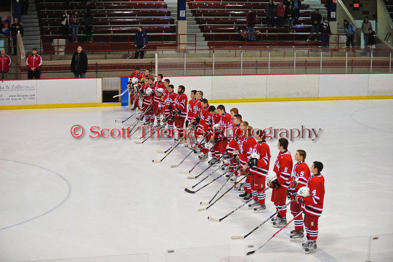 Baldwinsville Bees line up along the blue line for the national anthem before the game against the the Liverpool Warriors at the New York State Fairground's Coliseum in Syracuse, New York. Baldwinsville won 6 to 1.