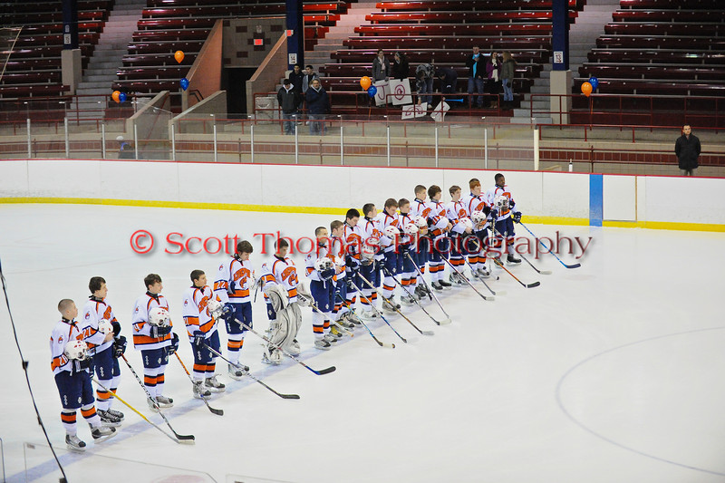 Liverpool Warriors line up on the blue line for the national anthem before the game against the Baldwinsville Bees at the New York State Fairground's Coliseum in Syracuse, New York. Baldwinsville won 6 to 1.