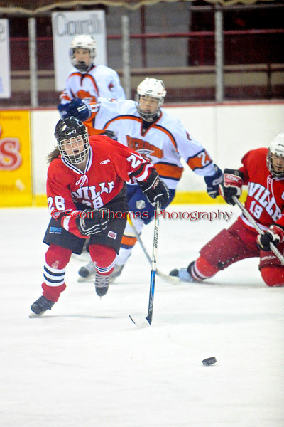Baldwinsville Bees Courtney Stocker (28) chases after the puck in a game against the Liverpool Warriors at the New York State Fairground's Coliseum in Syracuse, New York. Baldwinsville won 6 to 1.