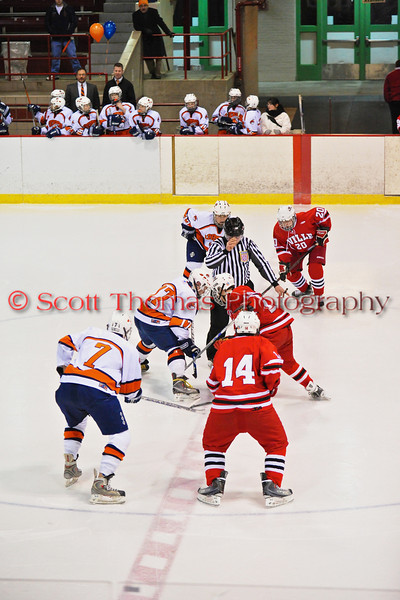Opening game faceoff between the Baldwinsville Bees and Liverpool Warriors at the New York State Fairground's Coliseum in Syracuse, New York. Baldwinsville won 6 to 1.