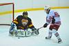 Ontario Bay goalie Justin Geddings stops a scoring attempt by Baldwinsville Bees Matt Zandri (22) on Thursday, January 6, 2011 at the Greater Baldiwnsville Ice Arena. Baldwinsville won 7 to 4.
