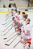 Baldwinsville Bees line up at the blue line for the national anthem before a game against the West Genesee Wildcats at the Greater Baldwinsville Ice Arena in Lysander, New York. West Genesee won 3 to 0.