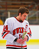 Baldwinsville Bees captain Steve Schneid (14) on Senior Night before the game against the McQuaid Knights at the Greater Baldwinsville Ice Arena in Baldwinsville, New York.