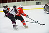 Baldwinsville Bees Ronnie May (26) skates around a Corcorcan Cougars defender at Meachem Ice Rink in Syracuse, New York.  Baldwinsville won 6-5.