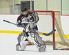 Corcorcan Cougars goalie TJ Hodgson (21) makes a save against the Baldwinsville Bees at Meachem Ice Rink in Syracuse, New York.  Baldwinsville won 6-5.