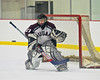 Corcorcan Cougars goalie TJ Hodgson (21) watches a shot from a Baldwinsville Bees player at Meachem Ice Rink in Syracuse, New York.  Baldwinsville won 6-5.