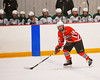 Baldwinsville Bees forward Parker Ferrigan (18) looking to make a play as he crosses into the Fayetteville-Manlius Hornets zone in Section III Boys Ice Hockey at Cicero Twin Rinks in Cicero, New York on Friday, January 6, 2012. Fayetteville-Manlius  won 4-2.