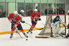Baldwinsville Bees players Dan Strodel (24) and Brendan Polsin (9) coming out from behind the Fayetteville-Manlius Hornets net in Section III Boys Ice Hockey at Cicero Twin Rinks in Cicero, New York on Friday, January 6, 2012. Fayetteville-Manlius  won 4-2.