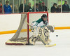 Fayetteville-Manlius Hornets goalie Ben Napierala (30) watches the puck flipped in front of his goal during a game with the Baldwinsville Bees in Section III Boys Ice Hockey at Cicero Twin Rinks in Cicero, New York on Friday, January 6, 2012. Fayetteville-Manlius  won 4-2.