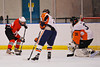 Baldwinsville Bees Ronnie May (26) getting ready to shoot on goal against the Solvay Bearcats goalie Ryan Bonk (31) in the Allyn Ice Arena in Skaneateles, New York.