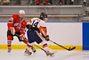 Baldwinsville Bees Dan Strodel (24) clears the puck past Solvay Bearcats Nathan Carr (14) in the Allyn Ice Arena in Skaneateles, New York.