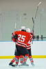Baldwinsville Bees players celebrate a goal against the Solvay Bearcats in the Allyn Ice Arena in Skaneateles, New York.