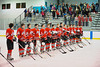 Baldwinsville Bees hockey team lined up for the Natinal anthem before the game against the Solvay Bearcats in the Allyn Ice Arena in Skaneateles, New York.