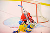West Genesee Wildcats forward Erik Kurz (10) slides into Baldwinsville Bees goalie Chris Johns (30) during Section III Boys Ice Hockey at Shove Park in Camillus, New York on Wednesday, December 21, 2011.  West Genesse won 6-2.